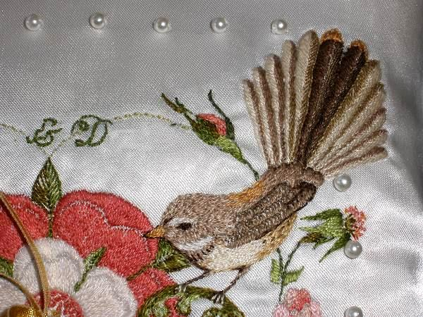 embroidered fantail on ring cushion