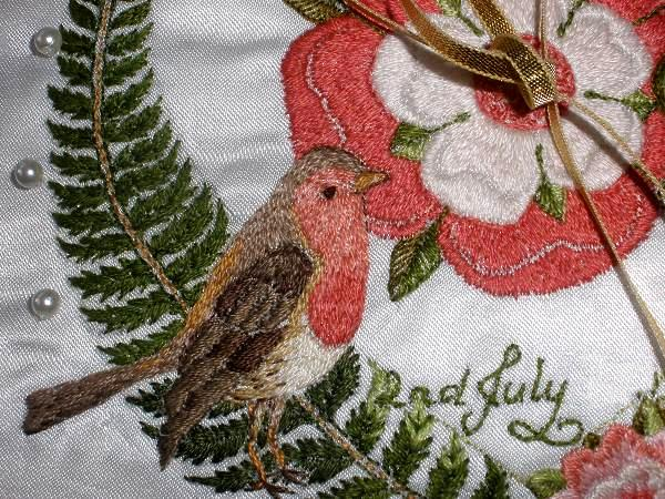 embroidered red robin on ring cushion